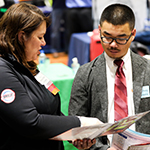 Student Reviewing Resume at the Career Fair