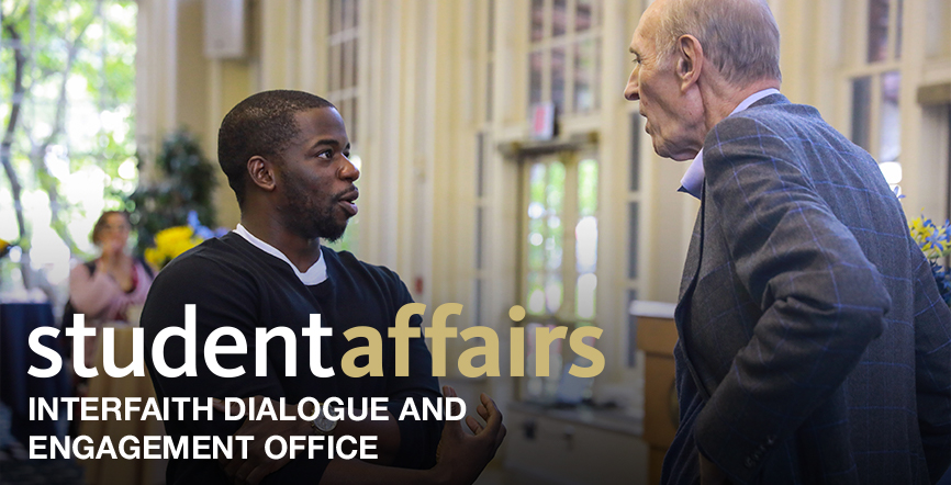 Student Affairs Office of Interfaith Dialogue and Engagement Office. Two people in discussion.