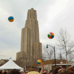 Cathedral of Learning with beach balls in the air